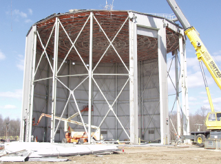 Crews dismantle a reactor facility.