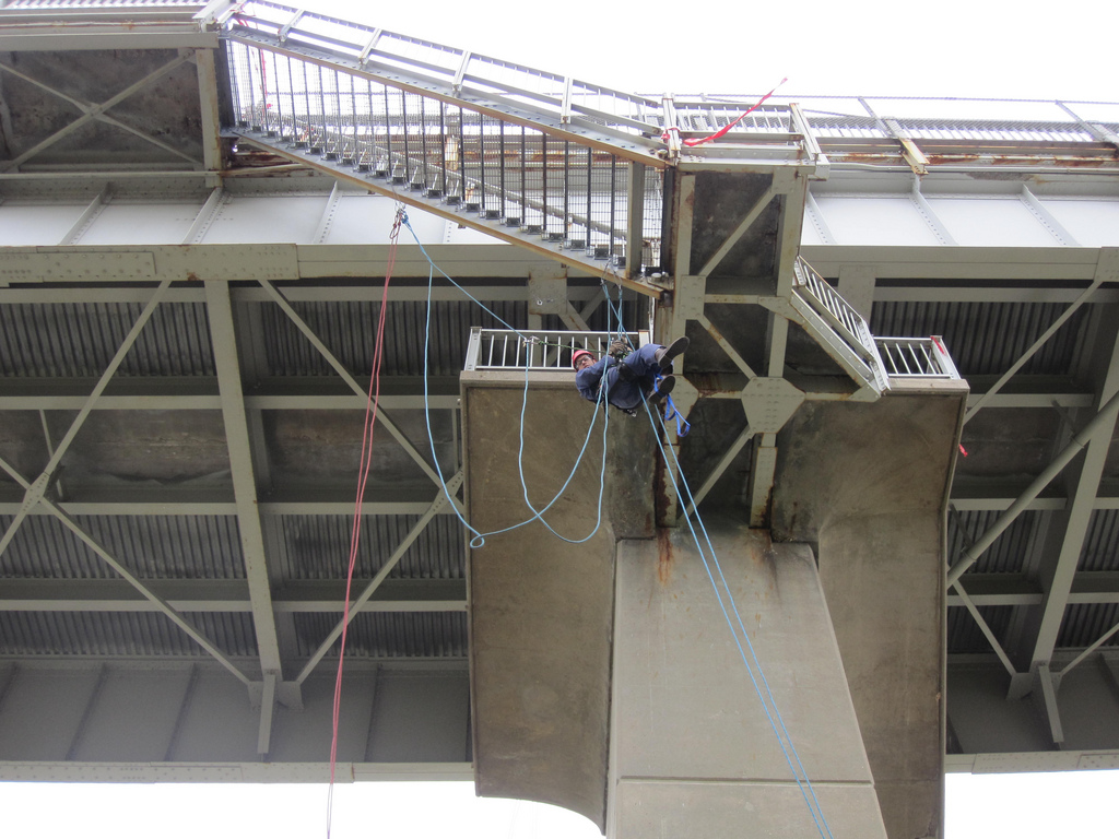 A U.S. Army Corps of Engineers employee performing a bridge inspection.